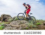 cyclist descending down the... | Shutterstock . vector #1163238580