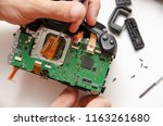 repair of a broken digital slr ... | Shutterstock . vector #1163261680