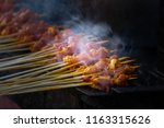 satay being grilled with smoke... | Shutterstock . vector #1163315626