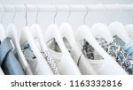gray clothing on the hangers   Shutterstock . vector #1163332816