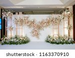 wedding backdrop with flower... | Shutterstock . vector #1163370910