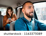smiling driver talking with... | Shutterstock . vector #1163375089