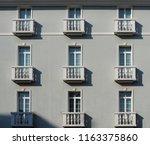 elegant light grey facade with... | Shutterstock . vector #1163375860