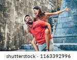 traveling couple of tourists... | Shutterstock . vector #1163392996
