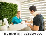 physical therapist looking at...   Shutterstock . vector #1163398900