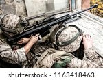 marines sniper team armed with... | Shutterstock . vector #1163418463