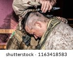 soldier cuts comrades hair with ... | Shutterstock . vector #1163418583