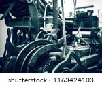 old press printing machine... | Shutterstock . vector #1163424103