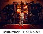 litlle toddler girl opens magic ... | Shutterstock . vector #1163426650