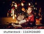 little toddler girl opens empty ... | Shutterstock . vector #1163426680