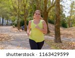 determined middle aged woman... | Shutterstock . vector #1163429599