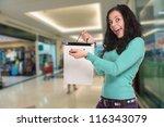 happy brunette showing her... | Shutterstock . vector #116343079