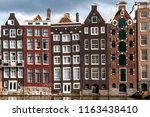 amsterdam canal houses  holland ... | Shutterstock . vector #1163438410