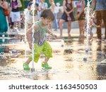 excited boy having fun between... | Shutterstock . vector #1163450503