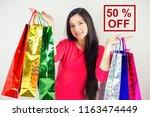 beautiful happy brunette female ... | Shutterstock . vector #1163474449
