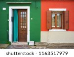 colorful wall in burano | Shutterstock . vector #1163517979