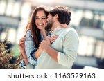 beautiful romantic couple... | Shutterstock . vector #1163529163