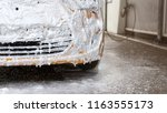 front bumper of yellow car... | Shutterstock . vector #1163555173