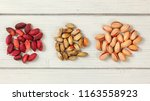 red turkish pistachios on white ... | Shutterstock . vector #1163558923