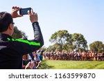 parents recoding a cross...   Shutterstock . vector #1163599870