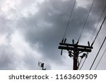 silhouette of power pole with... | Shutterstock . vector #1163609509