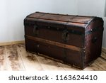 dark wood trunk in a country... | Shutterstock . vector #1163624410