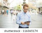 businessman read news on tablet ... | Shutterstock . vector #116365174