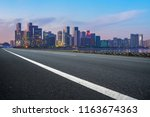 urban road asphalt pavement and ... | Shutterstock . vector #1163674363