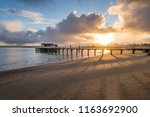 rainstorm and sunrise from... | Shutterstock . vector #1163692900