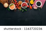 set the sauces on a black... | Shutterstock . vector #1163720236