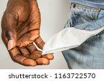 poor black man showing his... | Shutterstock . vector #1163722570