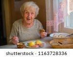 an elderly lady has dinner...   Shutterstock . vector #1163728336