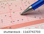 completed lottery ticket | Shutterstock . vector #1163742703