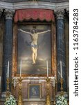 Small photo of Rome, Italy - 07/21/18 : Christ on the Cross of Guido Reni in the hight altar of the Basilica of St. Lawrence in Lucina, Rome