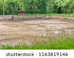 dewatered and excavated lake... | Shutterstock . vector #1163819146