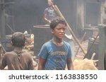 child labour  at the dockyard...   Shutterstock . vector #1163838550