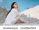 cute brunette woman in a white... | Shutterstock . vector #1163864569