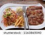 delicious  pork  steak. | Shutterstock . vector #1163865040