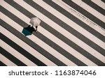 aerial view of people crossing... | Shutterstock . vector #1163874046