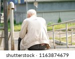 an lonely elderly gray haired...   Shutterstock . vector #1163874679