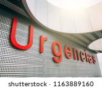 emergency entrance in spanish... | Shutterstock . vector #1163889160