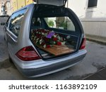 hearse with flowers | Shutterstock . vector #1163892109