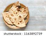 indian cuisine   tandoori roti... | Shutterstock . vector #1163892739