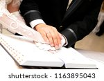 hand in hand on holy matrimony | Shutterstock . vector #1163895043