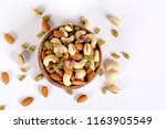 assorted nuts on white  dry... | Shutterstock . vector #1163905549