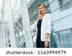 beautiful woman with phone work ... | Shutterstock . vector #1163994979