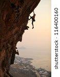 Rock Climber At Sunset ...