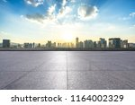 empty square with city skyline | Shutterstock . vector #1164002329