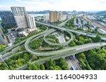 busy traffic road in urban | Shutterstock . vector #1164004933