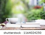 white coffee cup with notebooks ... | Shutterstock . vector #1164024250
